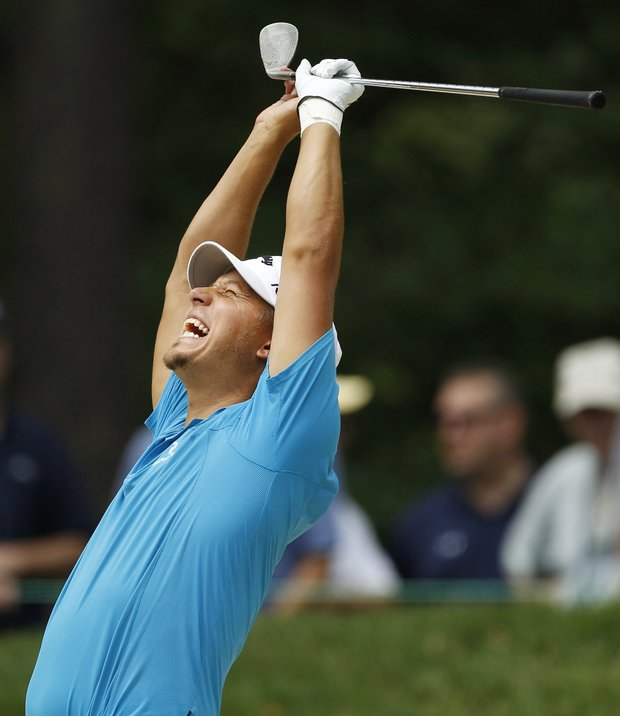 Fredrik Jacobson, of Sweden, reacts to his chip to the 12th green during the first round of the U.S. Open Championship golf tournament in Bethesda, Md., Thursday, June 16, 2011.