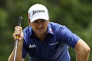 Graeme McDowell, of Northern Ireland, lines up his putt on the 15th green during the first round of the U.S. Open Championship golf tournament in Bethesda, Md., Thursday, June 16, 2011.
