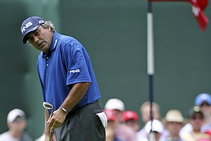 Angel Cabrera, of Argentina, watches his putt on the sixth green during the first round of the U.S. Open Championship golf tournament in Bethesda, Md., Thursday, June 16, 2011.