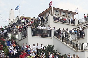 Golf fans watch from the club house at the Congressional County Club during the first round of the U.S. Open Championship golf tournament in Bethesda, Md., Thursday, June 16, 2011.