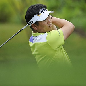Y. E. Yang, of South Korea, watches his shot from the 11th tee during the first round of the U.S. Open Championship golf tournament in Bethesda, Md., Thursday, June 16, 2011.