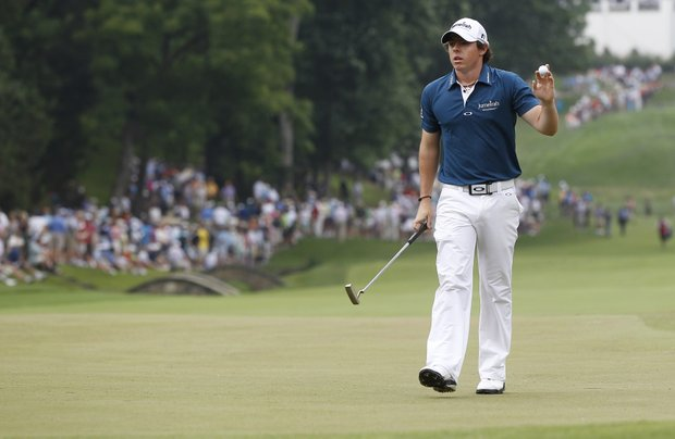 Rory McIlroy, of Northern Ireland, waves to the gallery as he walks across the 11th green during the first round of the U.S. Open Championship golf tournament in Bethesda, Md., Thursday, June 16, 2011.