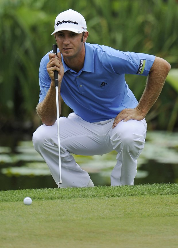 Dustin Johnson looks over his putt on the 10th green during the first round of the U.S. Open Championship golf tournament in Bethesda, Md., Thursday, June 16, 2011.
