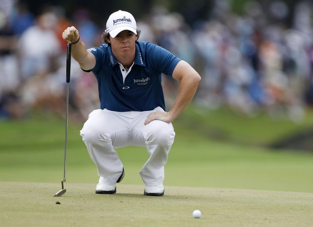 Rory McIlroy, of Northern Ireland, looks over his putt on the 11th green during the first round of the U.S. Open Championship golf tournament in Bethesda, Md., Thursday, June 16, 2011.