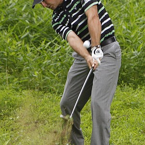 Trevor Immelman, of South Africa, hits out of the tall grass along the 11th fairway during the first round of the U.S. Open Championship golf tournament in Bethesda, Md., Thursday, June 16, 2011.