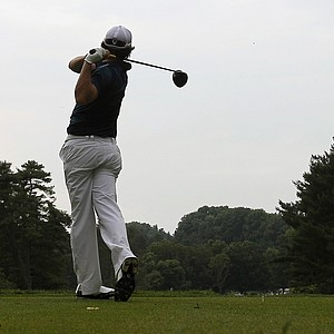 Rory McIlroy, of Northern Ireland, hits from the fourth tee during the first round of the U.S. Open Championship golf tournament in Bethesda, Md., Thursday, June 16, 2011.