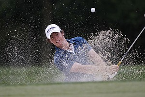 Rory McIlroy, of Northern Ireland, chips out of a bunker to the 14th green during the first round of the U.S. Open Championship golf tournament in Bethesda, Md., Thursday, June 16, 2011.