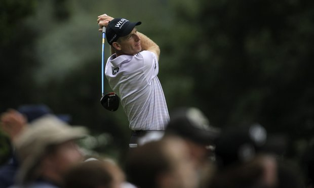 Jim Furyk watches his drive from the second tee during the first round of the U.S. Open Championship golf tournament in Bethesda, Md., Thursday, June 16, 2011.