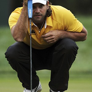 Johan Edfors, of Sweden, lines up his putt on the first green during the first round of the U.S. Open Championship golf tournament in Bethesda, Md., Thursday, June 16, 2011.