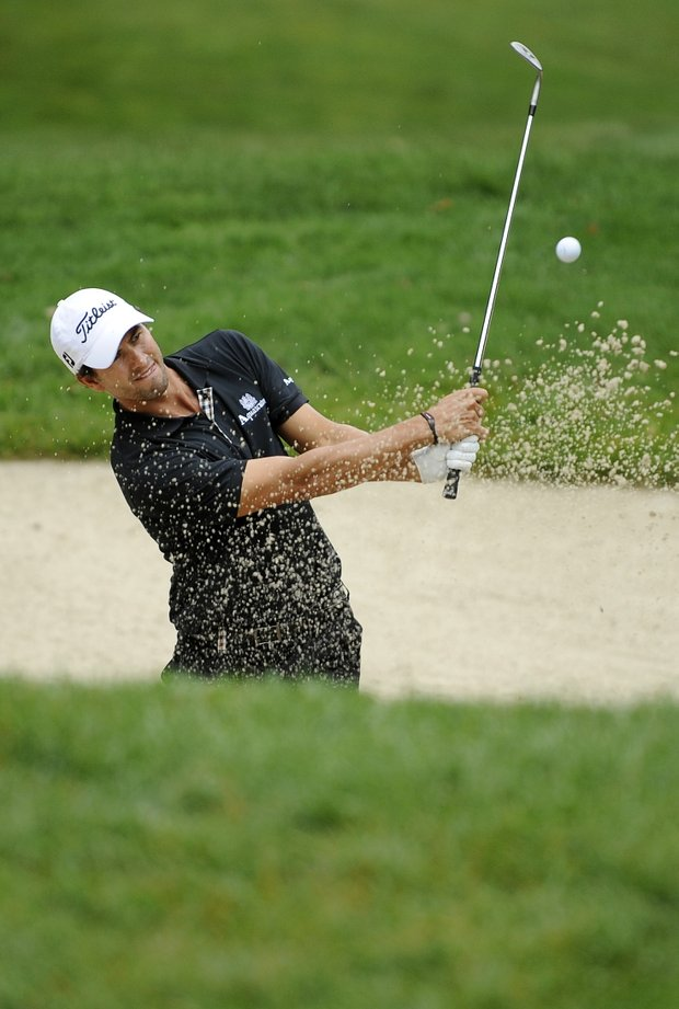 Adam Scott, of Australia, hits from the sand to the 13th green during the first round of the U.S. Open Championship golf tournament in Bethesda, Md., Thursday, June 16, 2011.