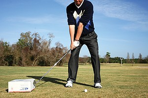 A good swing starts with a good takeaway. Smith uses a 2-by-4 to ensure his club gets started on the correct plane.