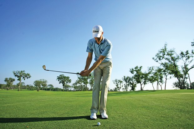 "Kirk keeps it simple with his short game, hitting most of his chip shots with a 60-degree wedge. ""I tend to use a lot of wrists,"" Kirk said. ""I hinge (my wrists) quickly, and then maintain the wrist angle through impact to trap the ball and create spin."" He changes his setup and backswing to control trajectory. Kirk places the ball in the middle of his stance for a standard chip shot. For a low shot, he aligns the ball off his right foot. He also sets his hands farther ahead of the ball at address, increases his wrist hinge and bows his left wrist more on the backswing to hit a low shot. ""I really bow the left wrist to deloft the clubface,"" Kirk said."