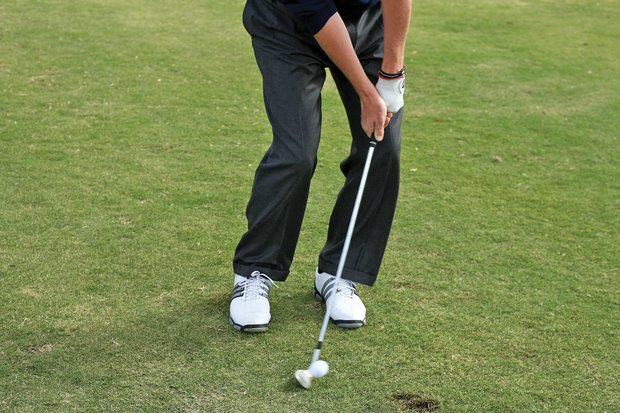 Smith's favorite short-game shot is a low, running chip. He places the ball just in front of his right foot, puts his hands well ahead of the clubhead and maintains that angle throughout the swing. One key: Even though his hands are ahead, he opens the clubface slightly. This does two things: It maintains the club's loft and keeps the sole from digging in the turf.