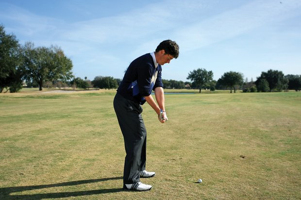 "This drill takes care of the rest of Smith's backswing. Smith ""sets"" the club at waist high, pauses, then completes his backswing. At waist high, Smith wants the club shaft to be parallel to his target line and the clubhead perpendicular