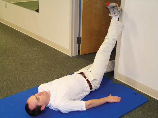 Ostrow says golfers must have loose hamstrings. In his testing, players with tight hamstrings tend to rise out of their posture during a swing, leading to inconsistent contact with the ball. Players with loose hamstrings were better able to stay in proper golf posture during the swing. This exercise can be performed by players with bad backs.  While keeping the back flat on the floor, lift one straightened leg onto the wall and hold the position. Alternate legs.