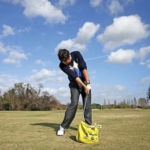 Smith uses an impact bag to
