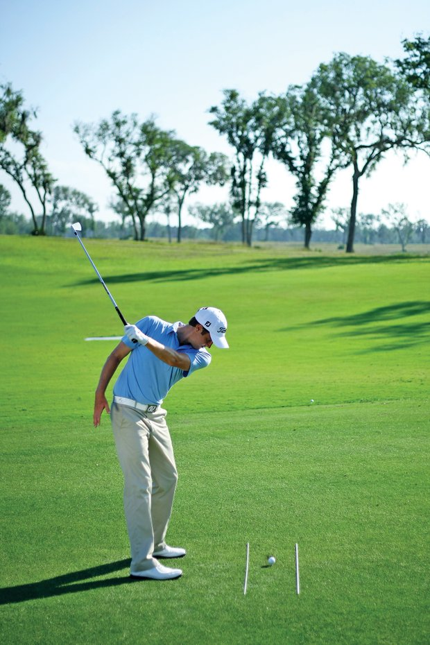 Kirk usually has to flip at the ball because his body moves too quickly in transition from backswing to downswing, causing the club head to fall behind the hands on the downswing. To sync his body and arms, he hits balls while holding the club with just his left hand. Because it is more difficult to control the club when holding it with one hand, this drill forces the player to keep the club in a more neutral position on the downswing. If the club falls behind the hands, as it does when Kirk is swinging poorly, it is difficult to hit the ball properly. The easiest way to hit the ball cleanly is for the clubhead to work on the proper plane, where it falls to the outside of the hands as it approaches the ball.