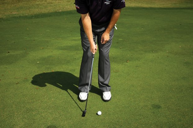 """Points hits putts while  holding the putter with  only his right hand to work on his release. """"This drill makes him swing the putter head,"""" Mogg said. """"The right hand is the feel hand. He feels the putter's weight naturally releasing the putter."""" Points used to lead with the grip through impact, which left the face open or forced him to flip the face closed, Mogg said. Points said this drill helps him better control the speed  of his putts because it makes his release more consistent."""