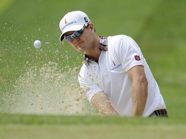 Zach Johnson watches his bunker shot to the 12th green during the second round of the U.S. Open Championship golf tournament in Bethesda, Md., Friday, June 17, 2011.