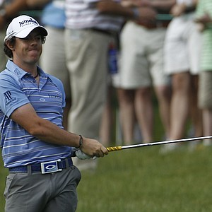 Rory McIlroy, of Northern Ireland, reacts to this approach shot on the second fairway during the second round of the U.S. Open Championship golf tournament in Bethesda, Md., Friday, June 17, 2011.
