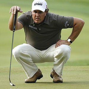 Phil Micklelson looks at his putt on the second green during the second round of the U.S. Open Championship golf tournament in Bethesda, Md., Friday, June 17, 2011.