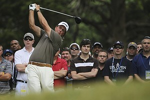 Phil Mickelson watches his drive from the third tee during the second round of the U.S. Open Championship golf tournament in Bethesda, Md., Friday, June 17, 2011.