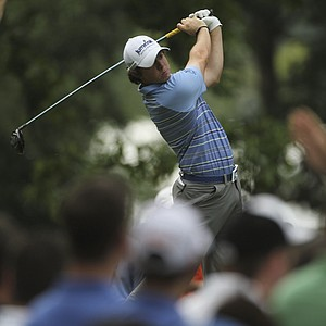 Rory McIlroy, of Northern Ireland, watches his drive from the fourth tee during the second round of the U.S. Open Championship golf tournament in Bethesda, Md., Friday, June 17, 2011.