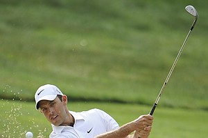 Charl Schwartzel, of South Africa, hits to the second green during the second round of the U.S. Open Championship golf tournament in Bethesda, Md., Friday, June 17, 2011.
