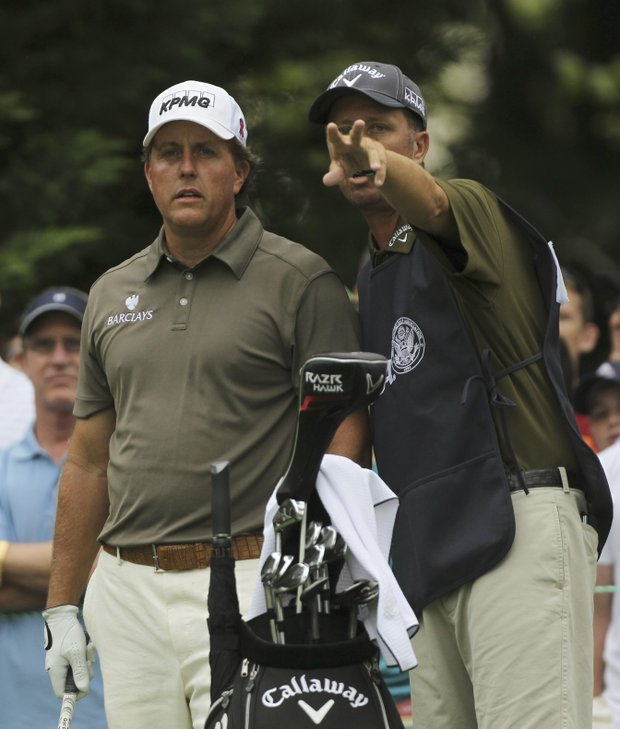 Phil Mickelson and his caddie James Mackay, look over the fairway from the fifth tee during the second round of the U.S. Open Championship golf tournament in Bethesda, Md., Friday, June 17, 2011.
