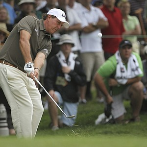 Phil Mickelson chips to the fourth green during the second round of the U.S. Open Championship golf tournament in Bethesda, Md., Friday, June 17, 2011.