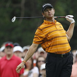 Retief Goosen, of South Africa, reacts to his drive from the eighth tee during the second round of the U.S. Open Championship golf tournament in Bethesda, Md., Friday, June 17, 2011.