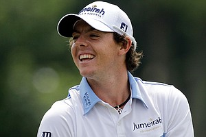 Rory McIlroy smiles as he waits to hit a shot on the practice range prior to the third round of the 111th U.S. Open.