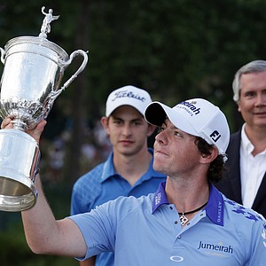 Rory McIlroy of Northern Ireland poses with the trophy after his eight-stroke victory on the 18th green during the 111th U.S. Open at Congressional Country Club on June 19, 2011 in Bethesda, Maryland.