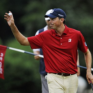 Matt Kuchar waves to the gallery on the 18th green during the third round of the U.S. Open Championship golf tournament in Bethesda, Md., Saturday, June 18, 2011.