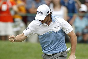 Rory McIlroy, of Northern Ireland, reacts after making his birdie putt on the 11th hole during the third round of the U.S. Open Championship golf tournament in Bethesda, Md., Saturday, June 18, 2011.
