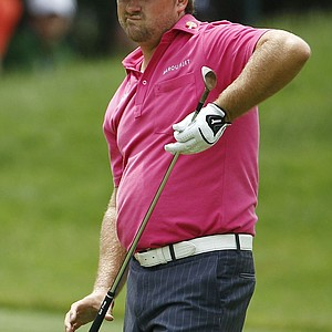 Graeme McDowell, of Northern Ireland, reacts to this approach shot from the sixth fairway during the third round of the U.S. Open Championship golf tournament in Bethesda, Md., Saturday, June 18, 2011.