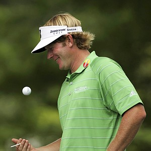 Brandt Snedeker tosses his golf ball while waiting to tee off on the first hole during the third round of the U.S. Open Championship golf tournament in Bethesda, Md., Saturday, June 18, 2011.