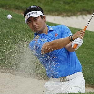 Y. E. Yang, of South Korea, hits out of the sand to the second green during the third round of the U.S. Open Championship golf tournament in Bethesda, Md., Saturday, June 18, 2011.