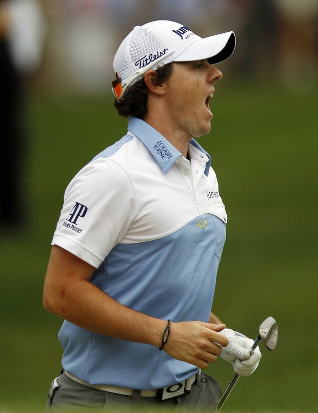 Rory McIlroy, of Northern Ireland, reacts to his chip to the fourth green during the third round of the U.S. Open Championship golf tournament in Bethesda, Md., Saturday, June 18, 2011.