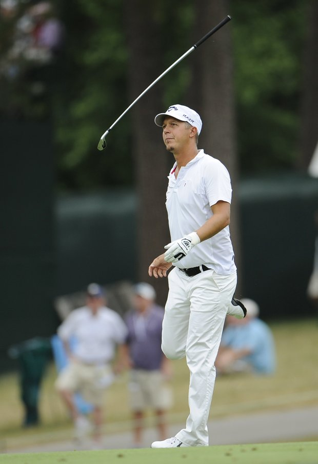 Fredrik Jacobson, of Sweden, kicks his club after this approach shot on the 15th fairway during the third round of the U.S. Open Championship golf tournament in Bethesda, Md., Saturday, June 18, 2011.