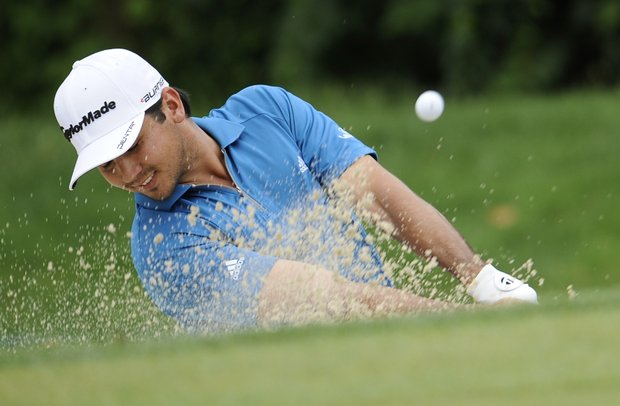 Jason Day, of Australia, hits out of the greenside bunker on the 14th hole during the third round of the U.S. Open Championship golf tournament in Bethesda, Md., Saturday, June 18, 2011.