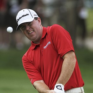 Robert Garrigus chips to the third green during the third round of the U.S. Open Championship golf tournament in Bethesda, Md., Saturday, June 18, 2011.