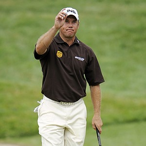 Lee Westwood, of England, acknowledges the gallery as he walks off of the 18th green during the third round of the U.S. Open Championship golf tournament in Bethesda, Md., Saturday, June 18, 2011.