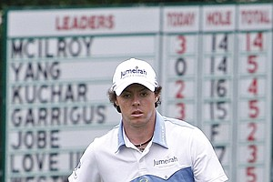 Rory McIlroy, of Northern Ireland, looks over his putt on the 15th green during the third round of the U.S. Open Championship golf tournament in Bethesda, Md., Saturday, June 18, 2011.