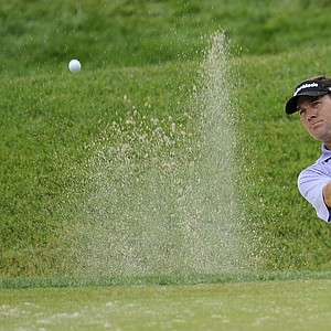 Brandt Jobe hits out of the sand to the 18th green during the third round of the U.S. Open Championship golf tournament in Bethesda, Md., Saturday, June 18, 2011.