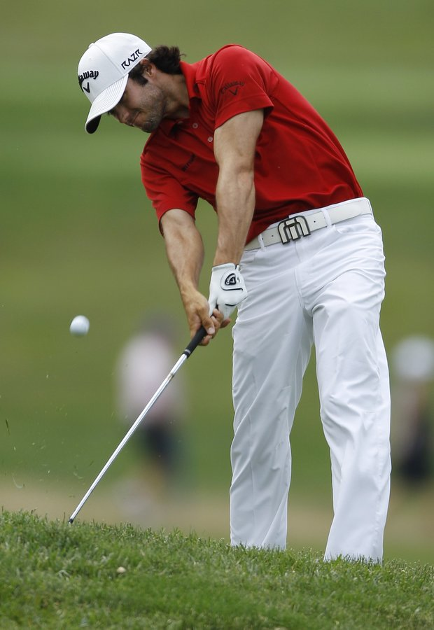 Adam Hadwin, of Canada, hits from the first fairway during the final round of the U.S. Open Championship golf tournament in Bethesda, Md., Sunday, June 19, 2011.