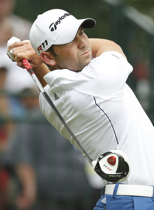 Sergio Garcia, of Spain, watches his drive from the first tee during the final round of the U.S. Open Championship golf tournament in Bethesda, Md., Sunday, June 19, 2011.