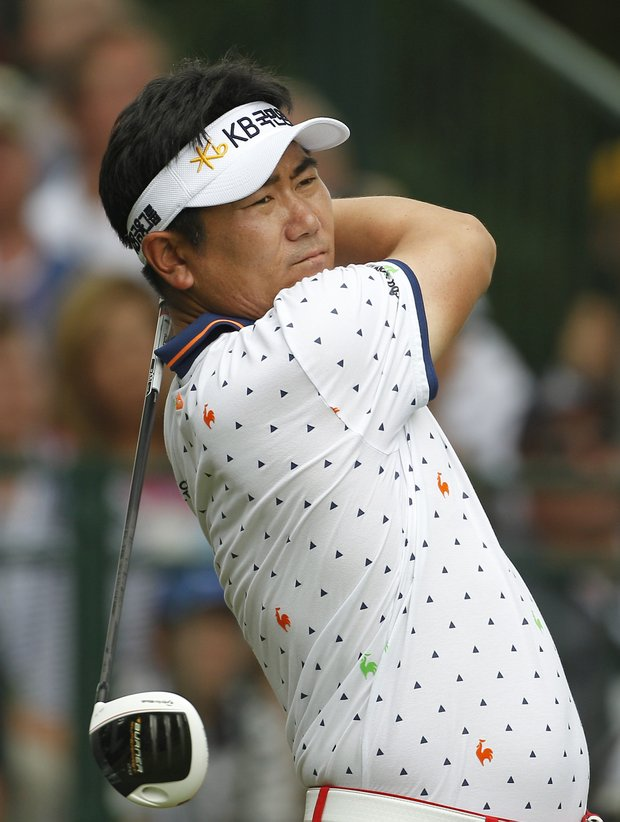 Y. E. Yang, of South Korea, watches his drive from the first tee during the final round of the U.S. Open Championship golf tournament in Bethesda, Md., Sunday, June 19, 2011.