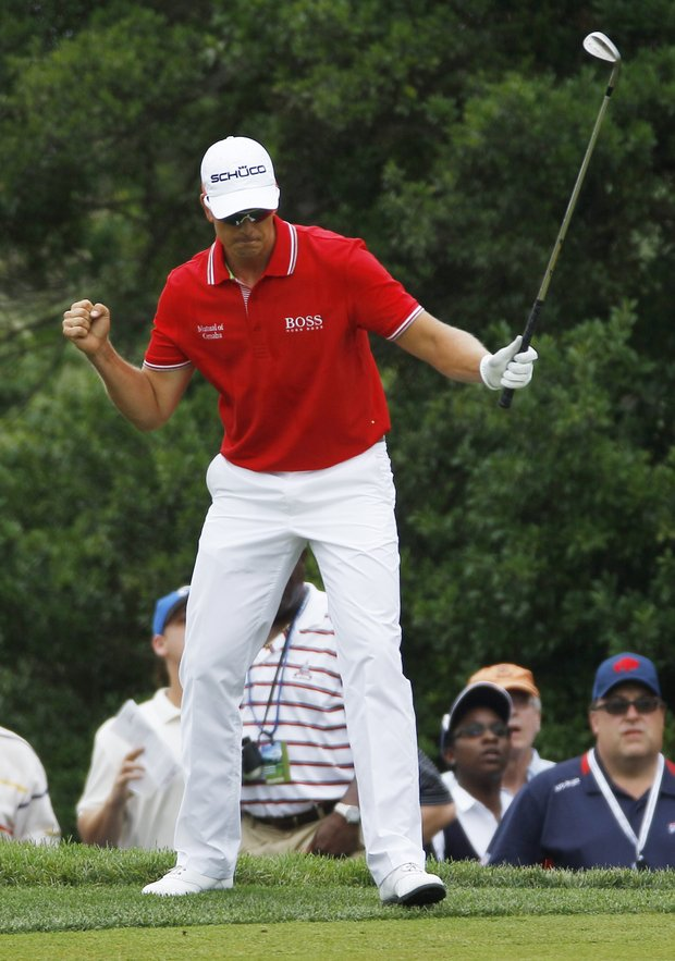 Henrik Stenson, of Sweden, reacts to a putt on the first green during the final round of the U.S. Open golf tournament in Bethesda, Md., Sunday, June 19, 2011.