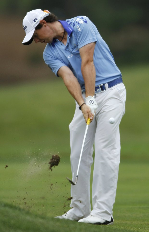 Rory McIlroy, from Northern Ireland, hits from the first fairway during the final round of the U.S. Open golf tournament in Bethesda, Md., Sunday, June 19, 2011.